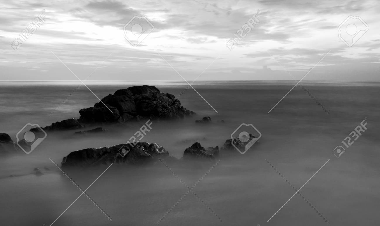 Long exposure of seascape scenery with rocks in black and whitebeautiful image can be