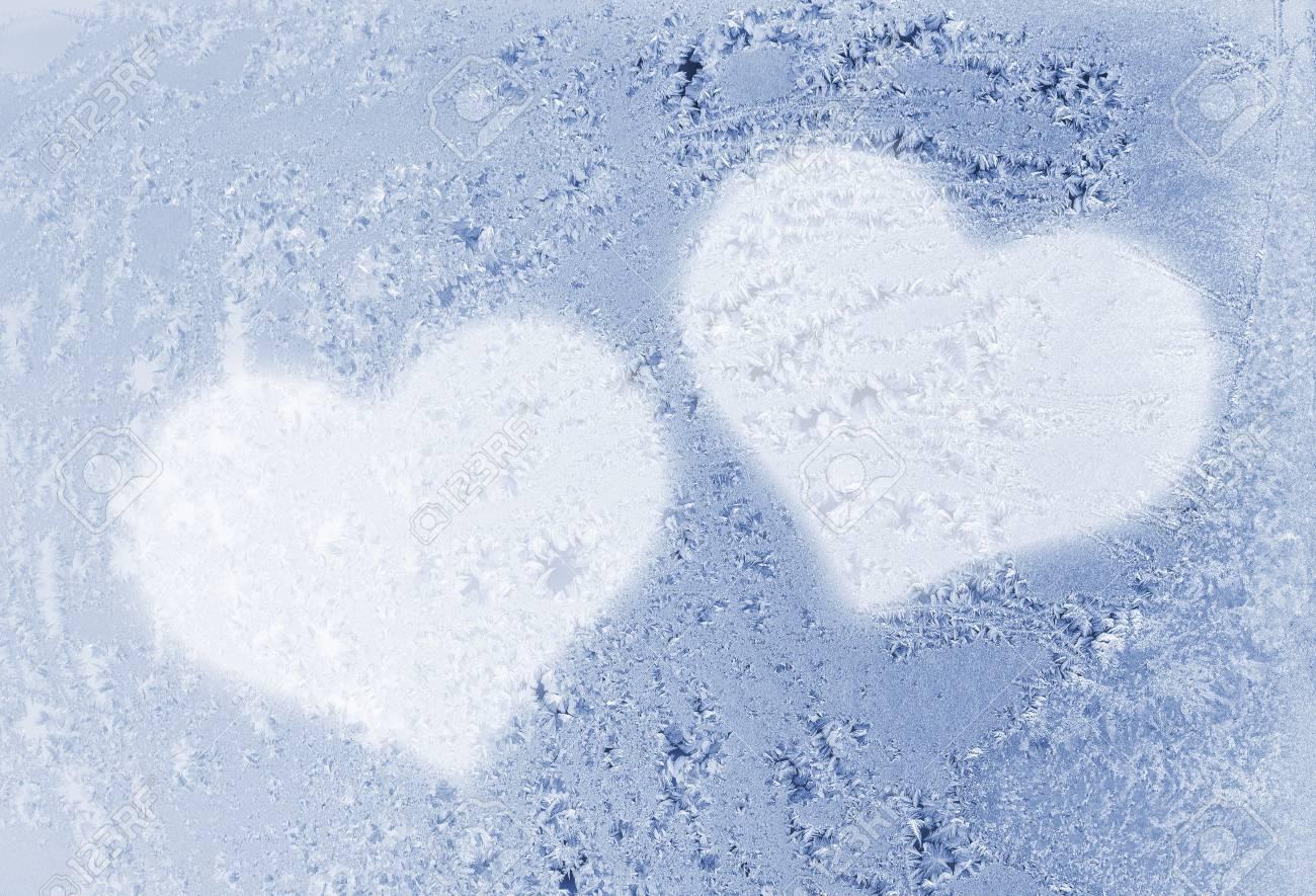 two hearts on the frozen glass Stock Photo - 7999705