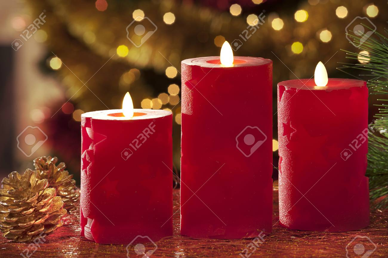 electric christmas candles in atmospheric light stock photo 33874823