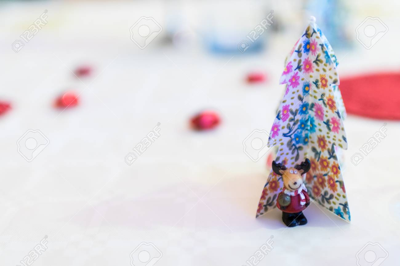 Christmas Decorations With Paper Christmas Trees And A Reindeer