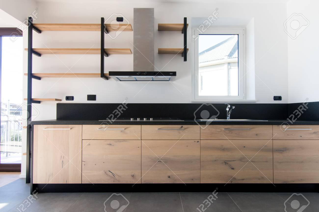 New Crafted Kitchen In Wood Stainless Steel And Black Granite