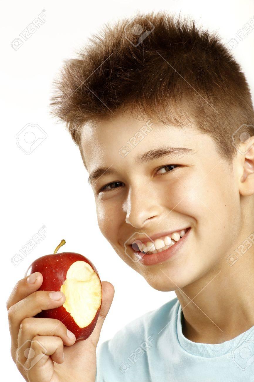 boy eat apple on white - 15041172