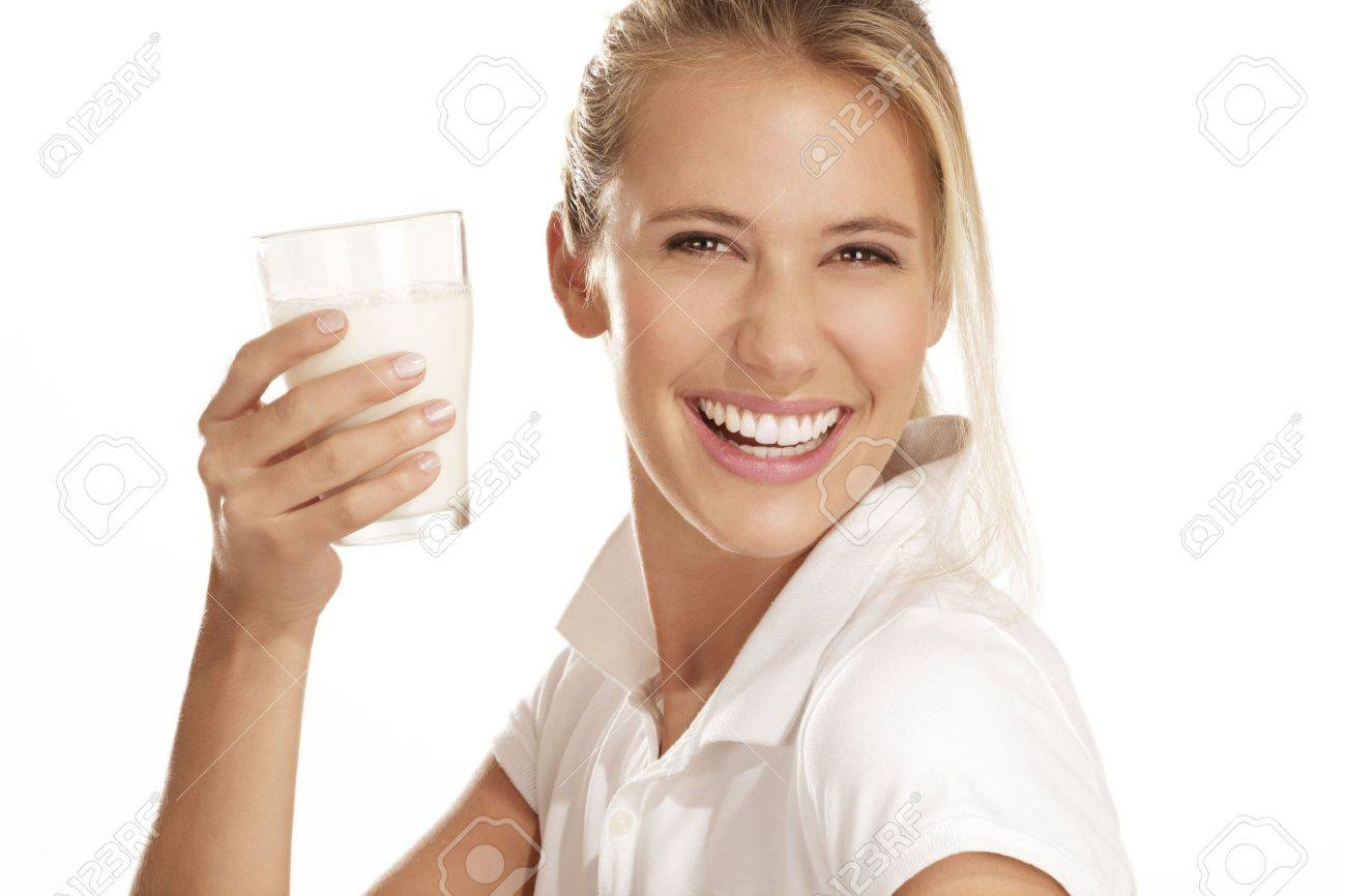 young woman drink milk on white background - 15936983