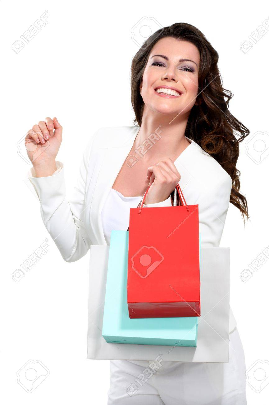 Young beautiful woman with shopping bag on white - 17643897