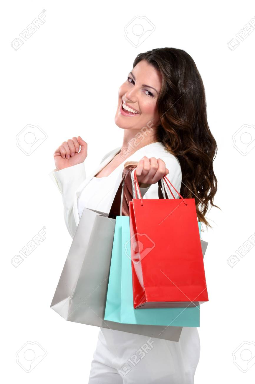 Young beautiful woman with shopping bag on white - 17643887