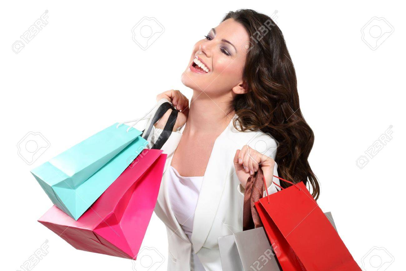 Young beautiful woman with shopping bag on white - 17643904