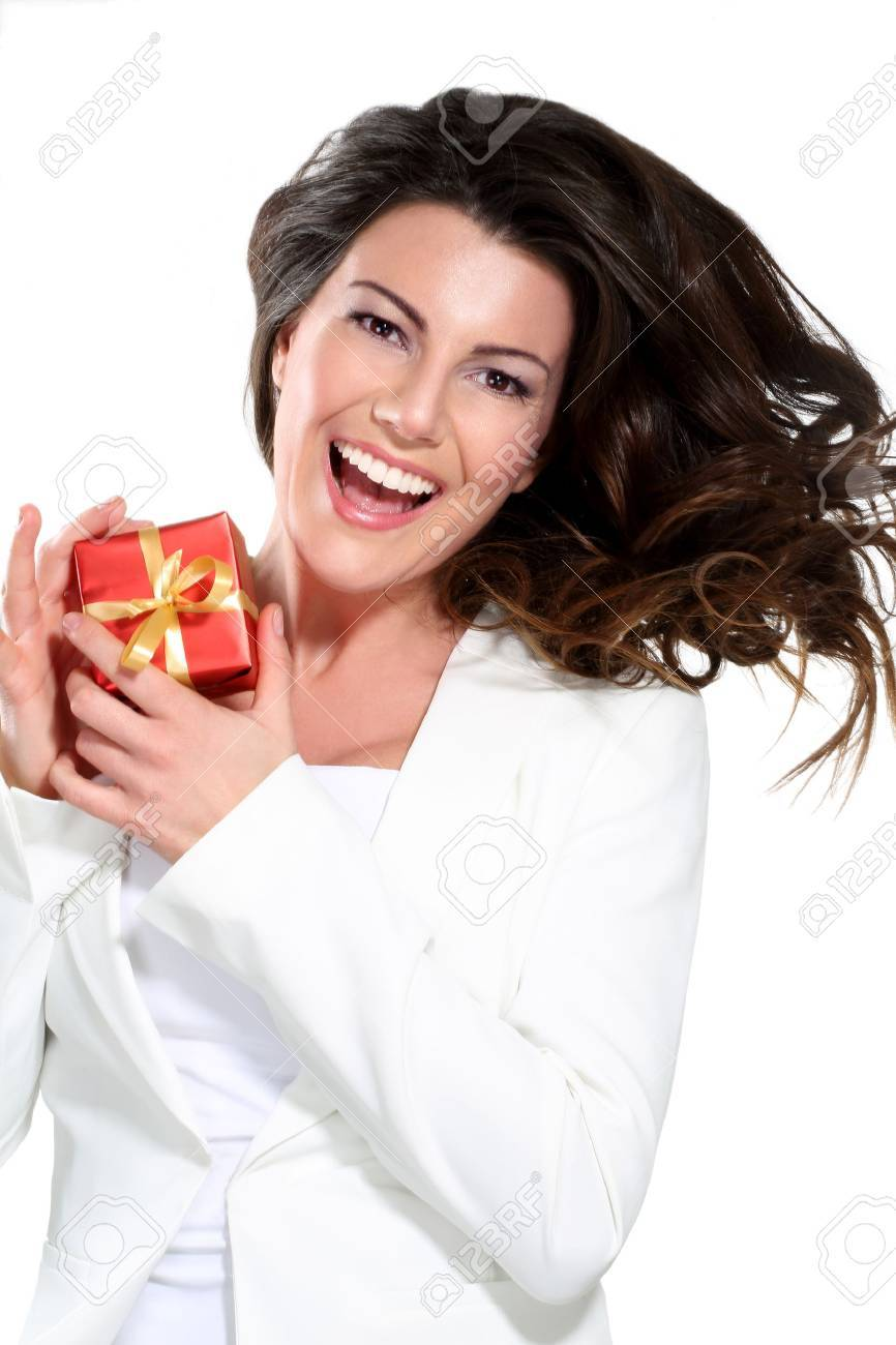 Young beautiful woman with a gift on white - 17643918