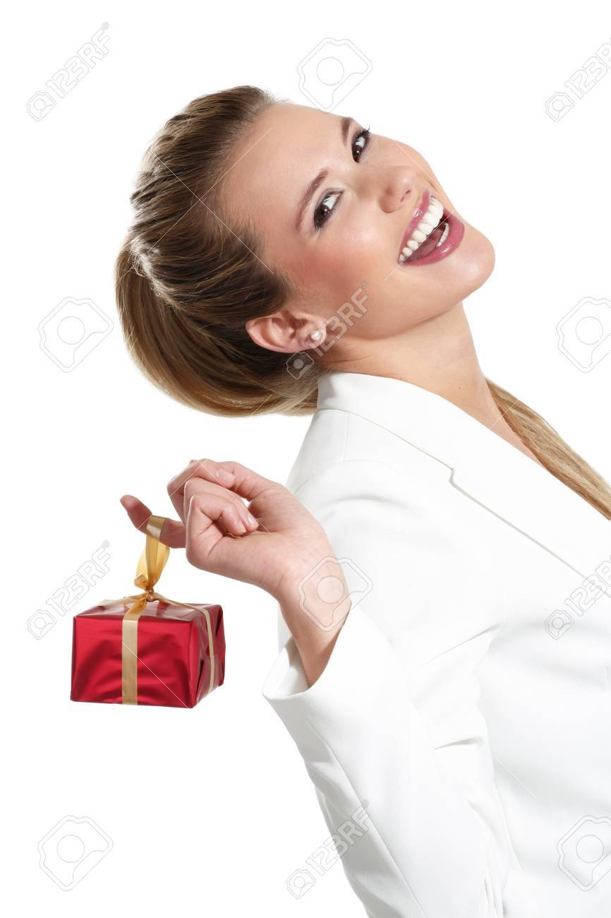 Young beautiful woman with a gift on a white background - 18498583
