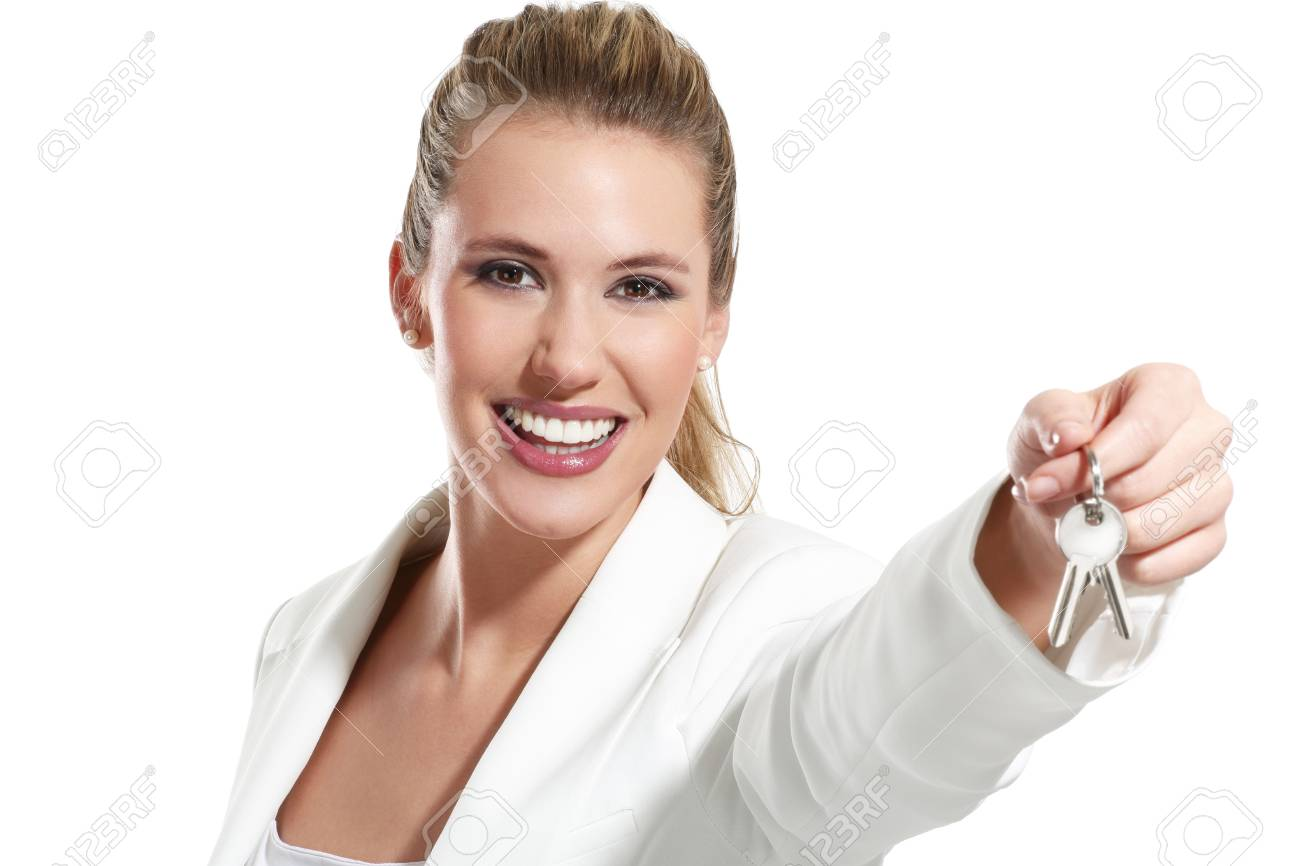 business woman with keys of an apartment on white Stock Photo - 18498601