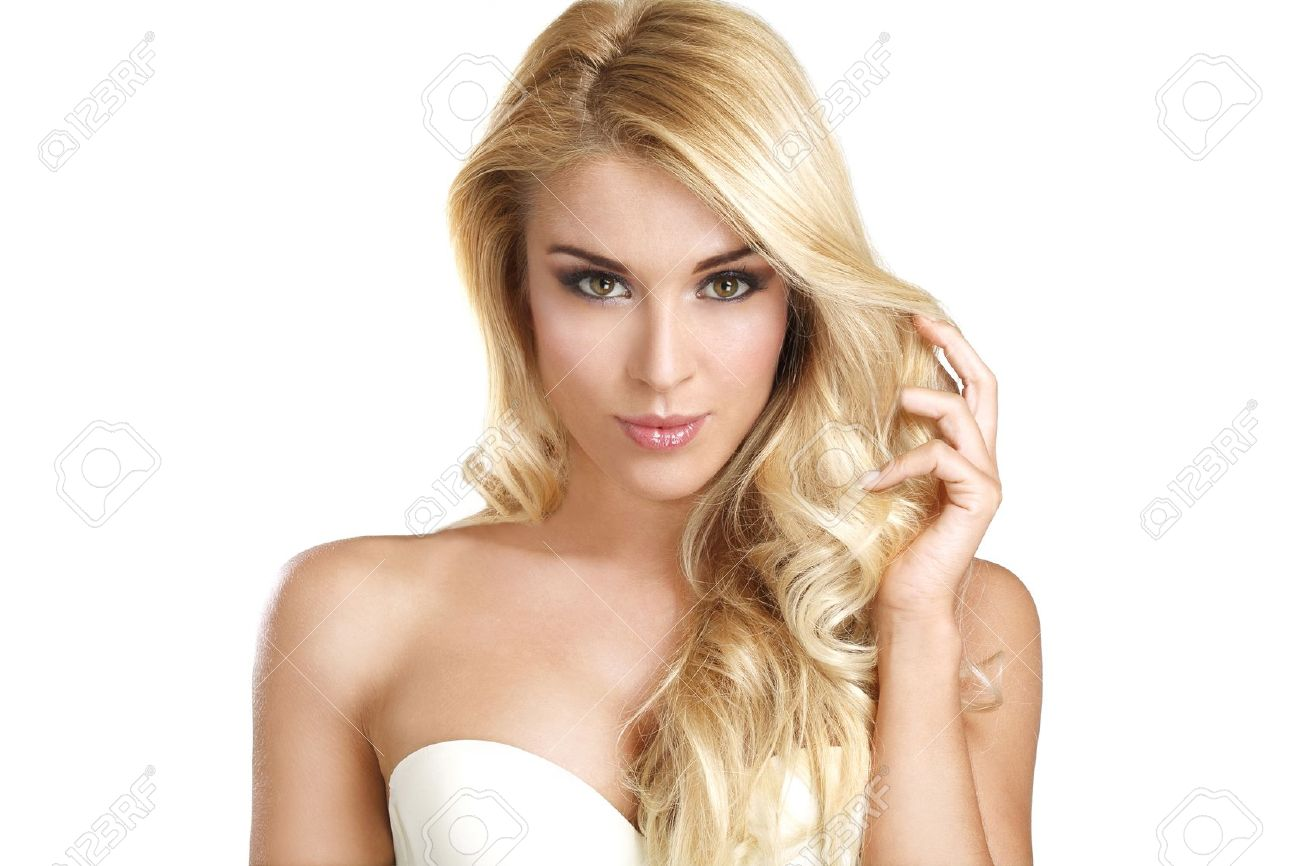young beautiful woman showing her blonde hair on white - 20306594