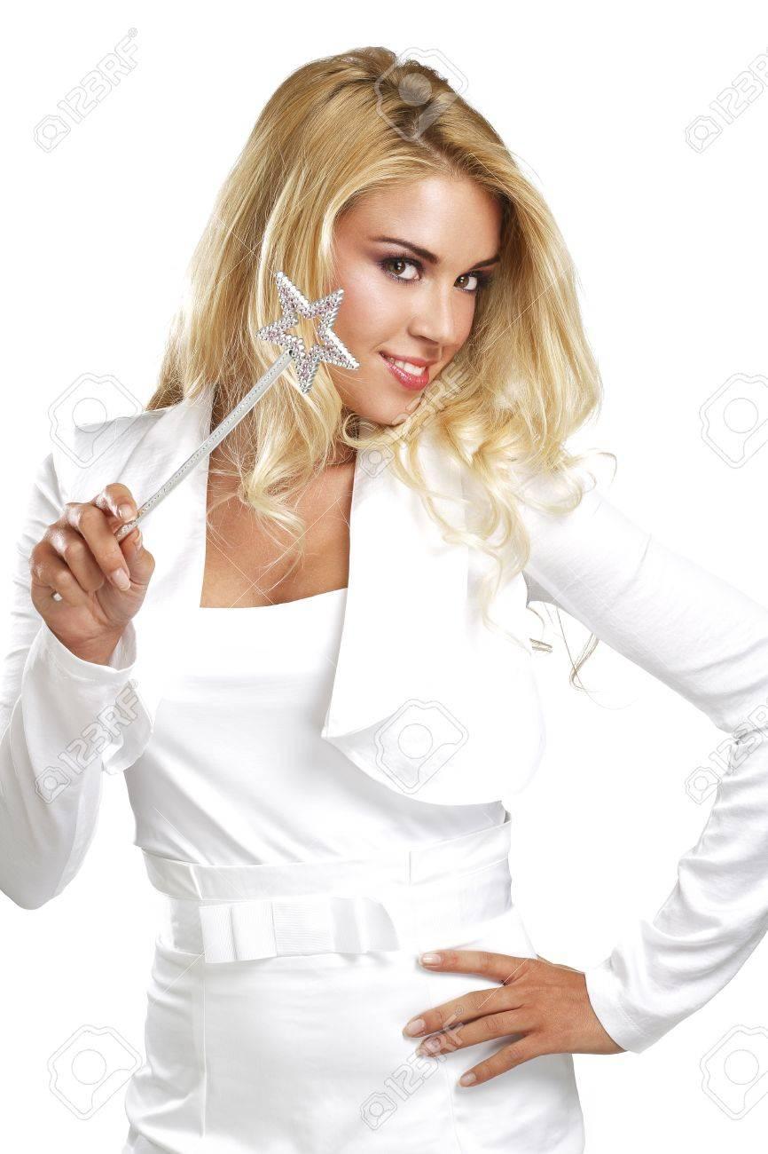 young beautiful woman holding a magic wand on white - 20174206