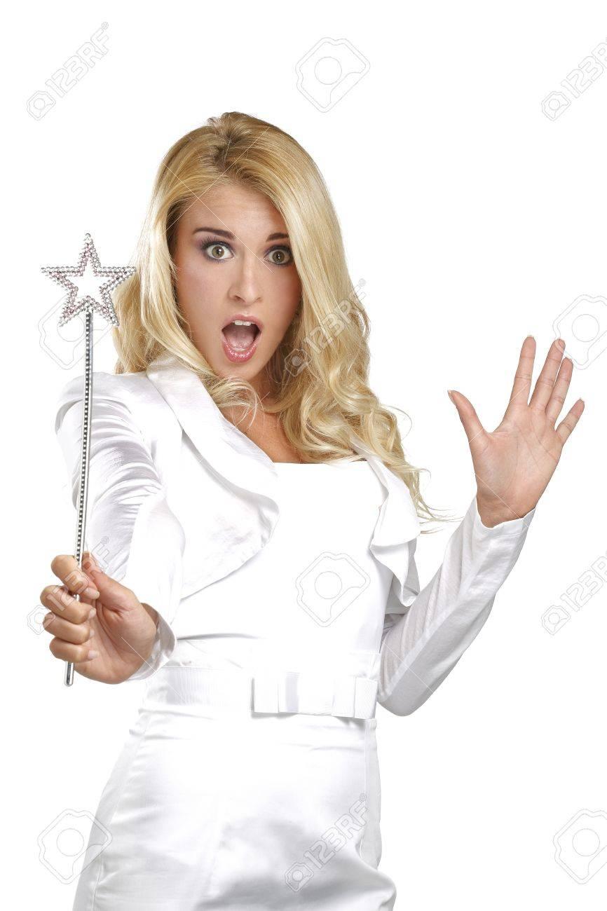 young beautiful woman holding a magic wand on white - 20174185