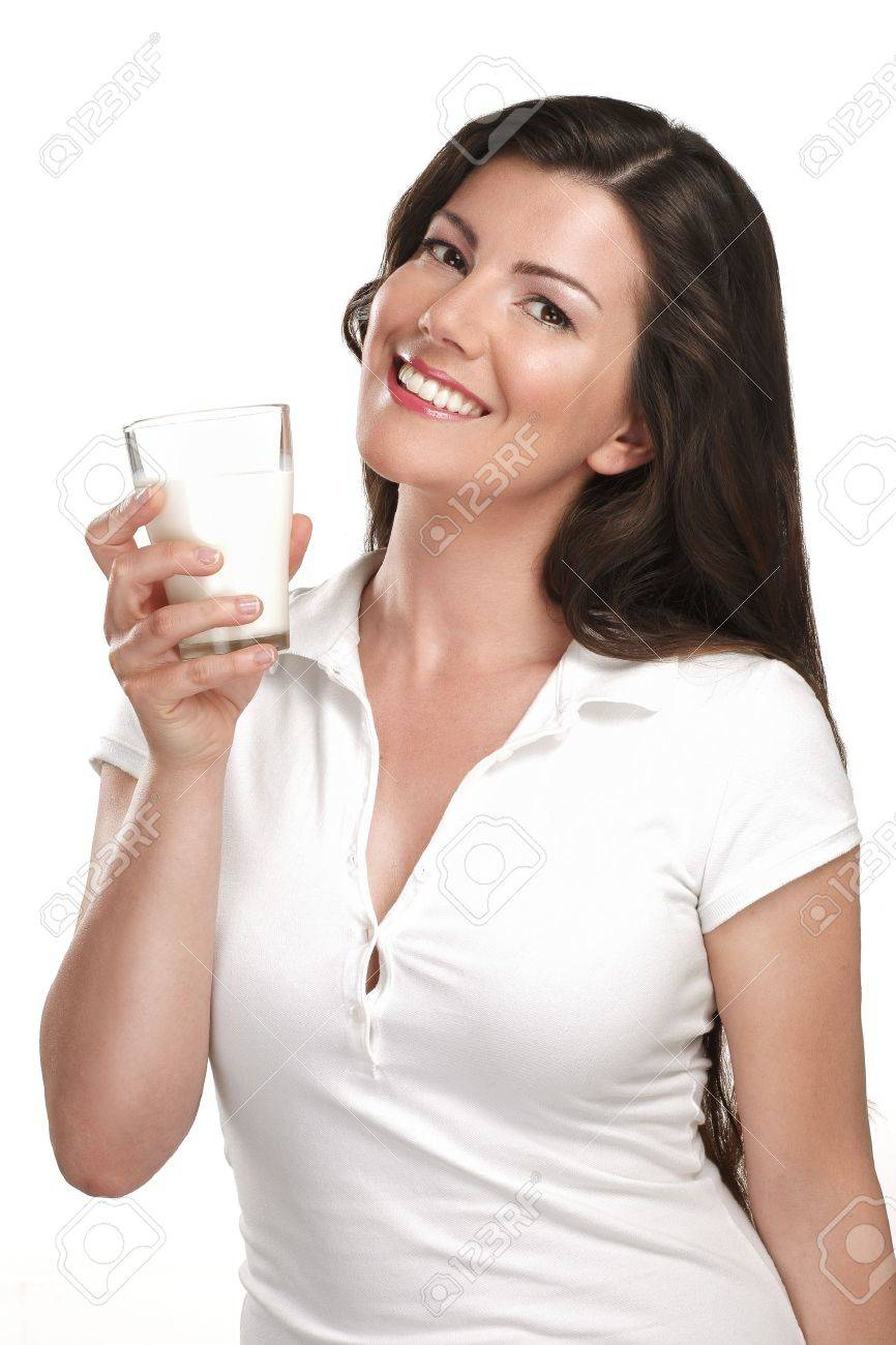 young beautiful woman drink a glass of milk on white - 20888526