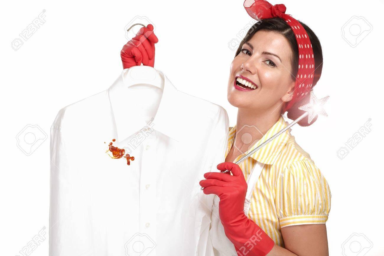 beautiful woman housewife showing a dirty shirt on white - 20888604