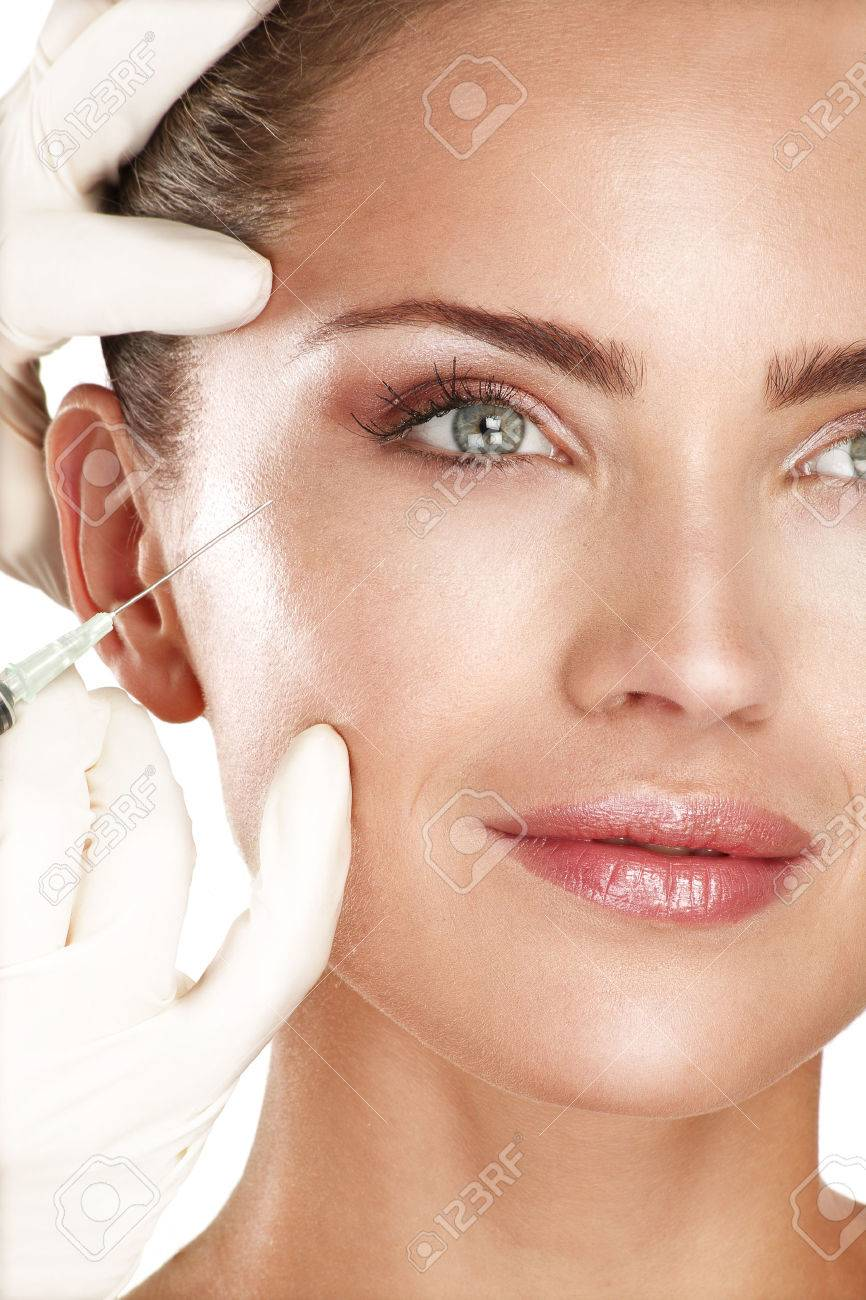 young beautiful model injecting a cosmetic treatment on white - 22642314