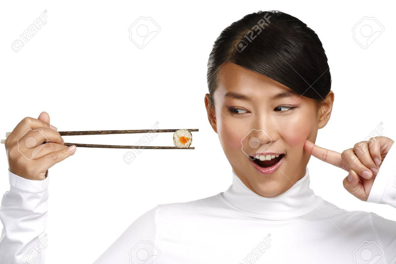 Chinese woman showing asian food using chopstick on white - 24479760