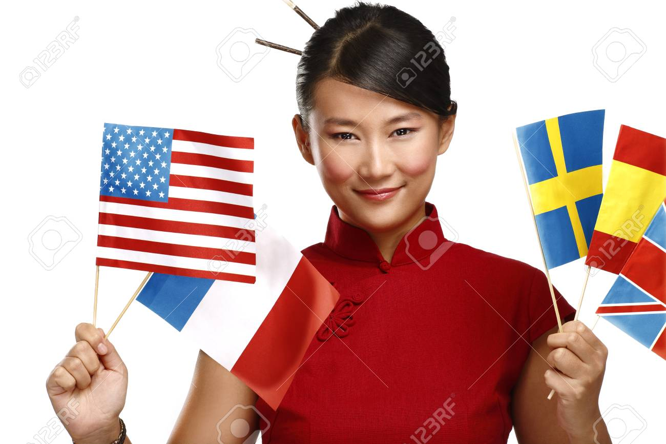Beautiful asian woman showing multicolor international flags on white - 24479776