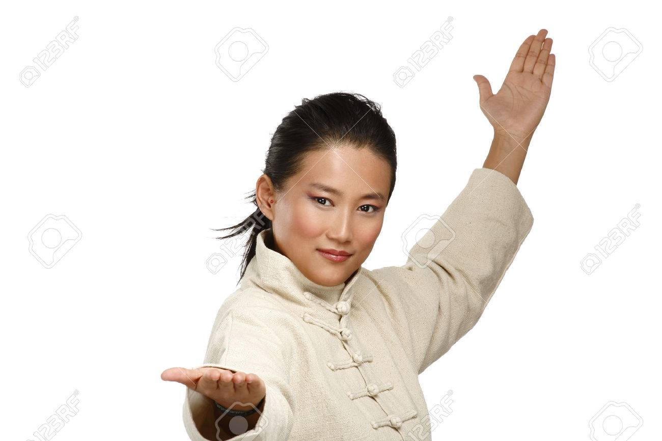 Beautiful asian woman make kung fu gesture on white - 24479808