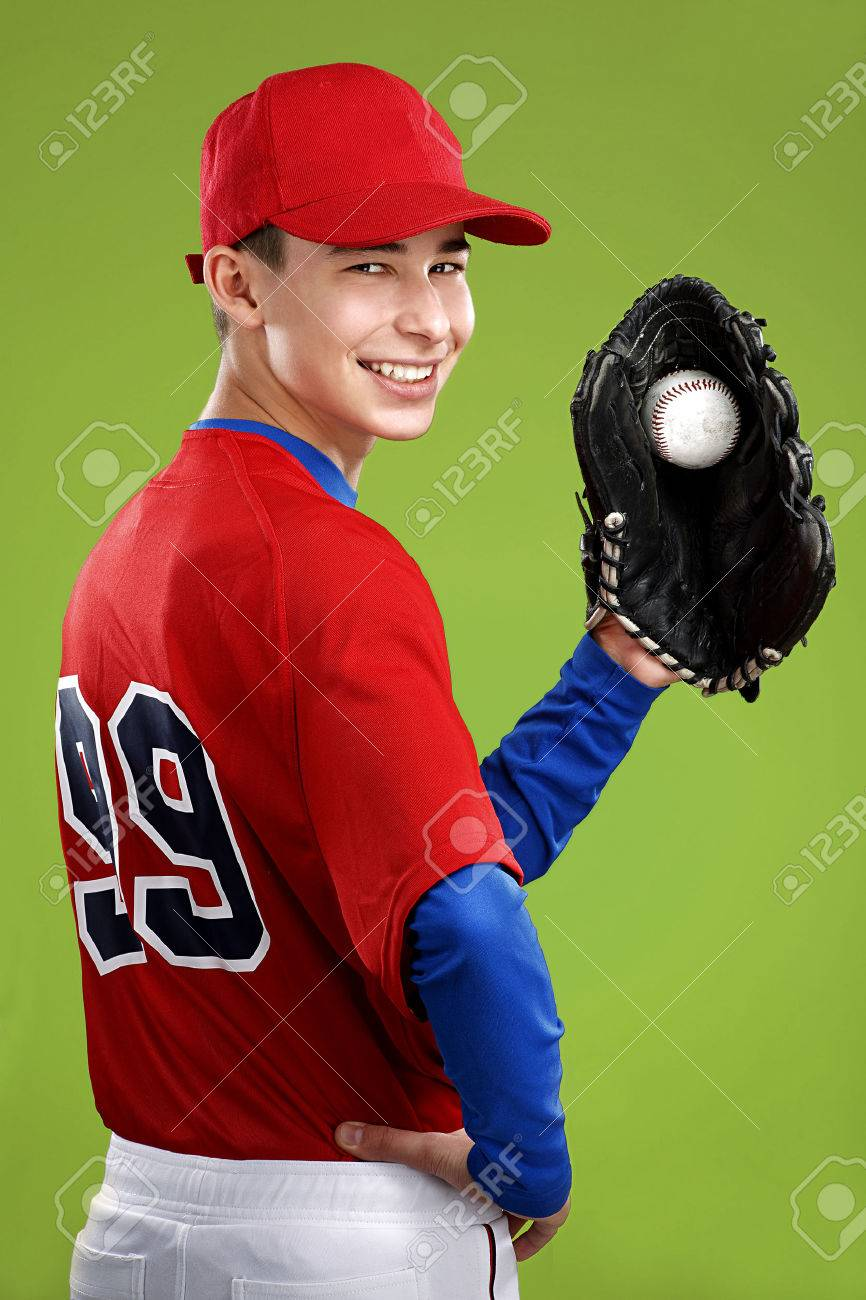 portrait of a beautiful teen baseball player in red and white uniform on colorful background - 26906546