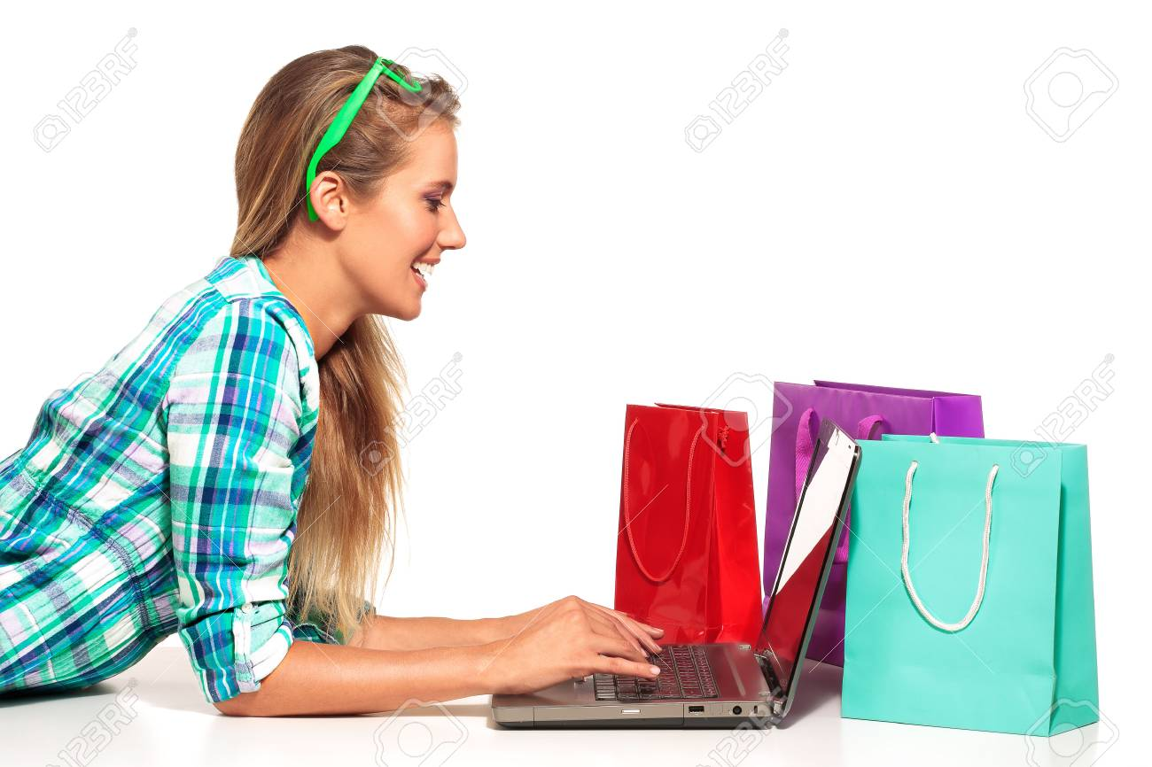 Young Woman Sitting at the desk shopping Online on white - 30316824