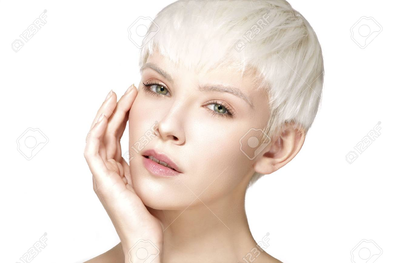 Beauty model blonde short hair showing perfect skin on white - 36360167