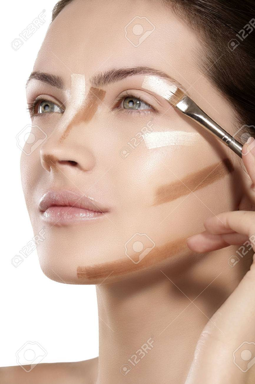 Beautiful Model Applying Foundation With A Brush On White Stock Photo Picture And Royalty Free Image Image 37768787