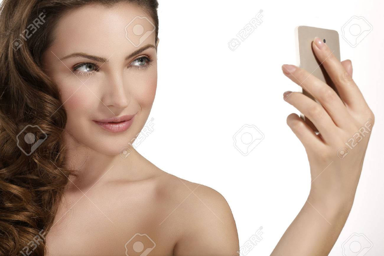 beautiful woman take a smiling selfie with smartfone on white - 37769106