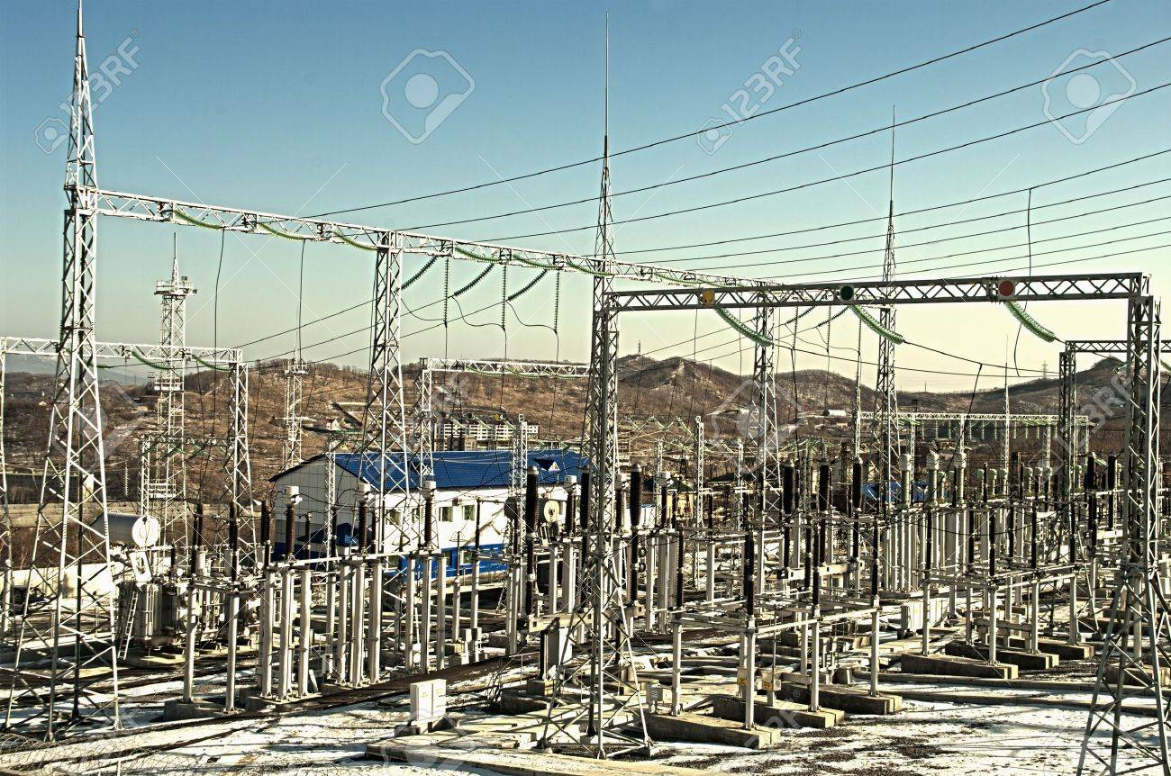 electrical transformers  sub-station on the blue background Stock Photo - 8558293