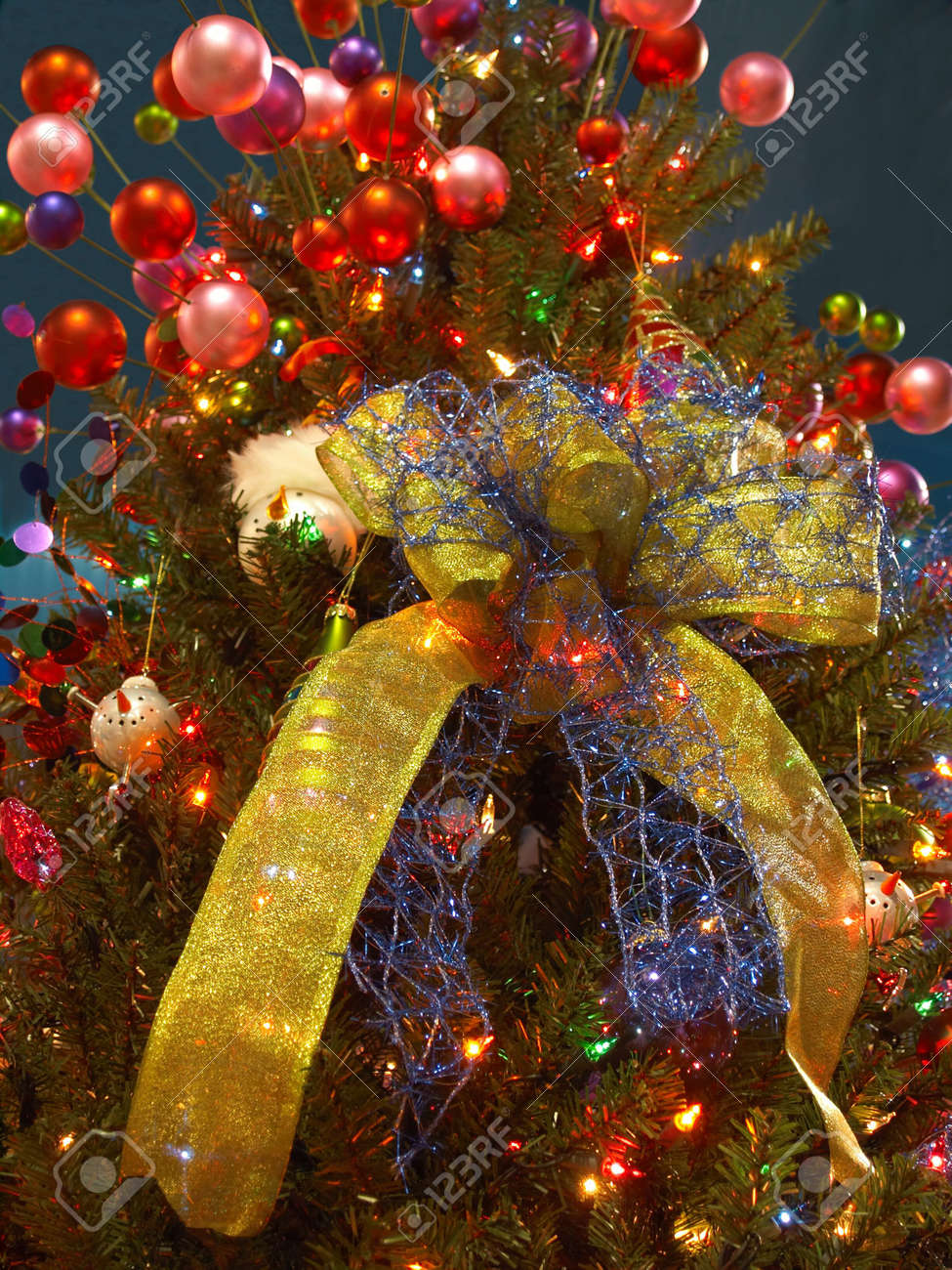 Christmas Tree Spray.Christmas Tree With Big Gold Ribbon And Spray Of Red Balls