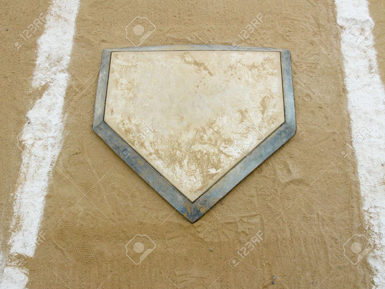 close up of home plate on a municipal baseball diamond stock photo