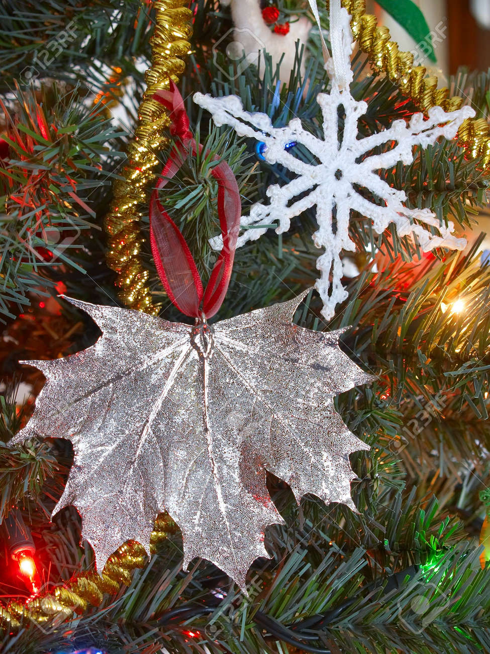 silver maple leaf ornament and fabric snowflake on a christmas stock photo picture and royalty free image image 3179851 silver maple leaf ornament and fabric snowflake on a christmas
