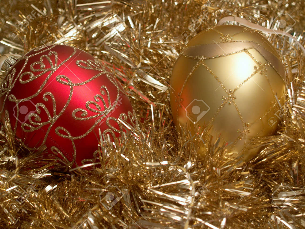 Red and gold christmas ornaments - Red And Gold Christmas Ornaments On A Bed Of Gold Tinsel Stock Photo 3352923