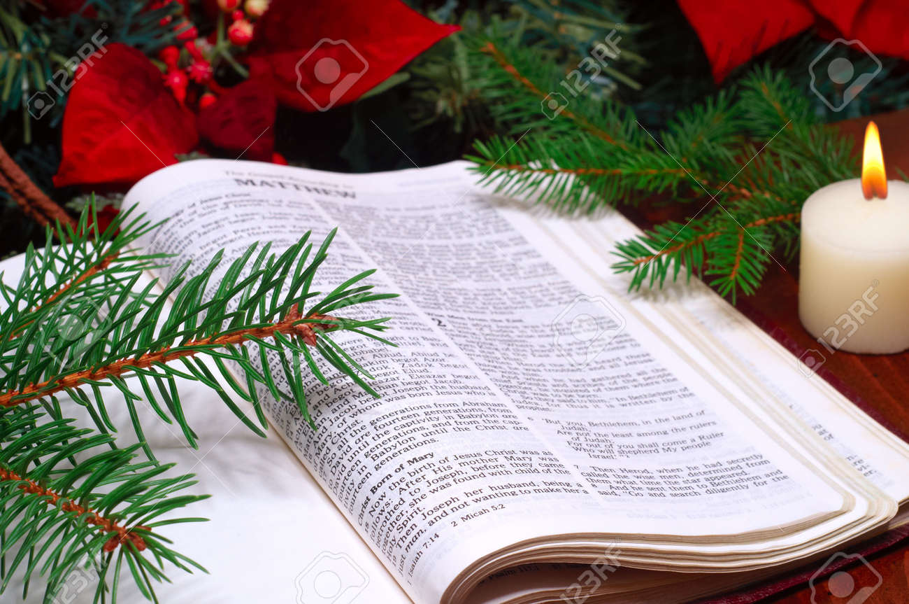 Bible Open To The Christmas Passage Of Matthew 2 With Candle ...