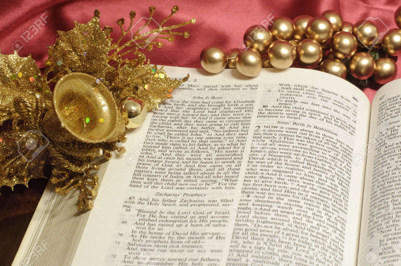 Bible Open To The Christmas Passage Of Luke 2 With Gold Decor Stock ...