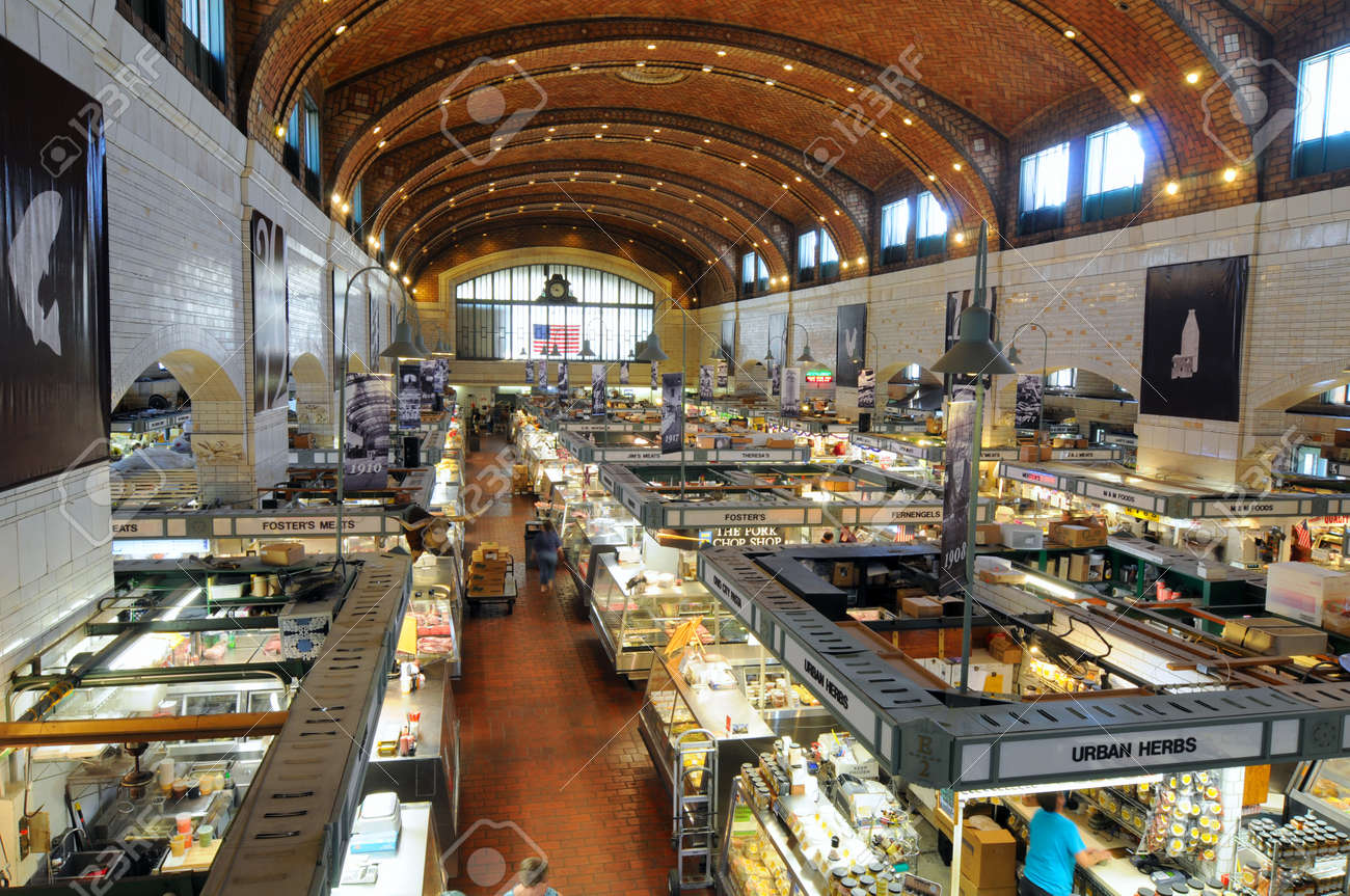 Cleveland, Ohio - June 27, 2012: The famed West Side Market, celebrating 100 years of continuous operation in 2012, opens for business in the early morning. Stock Photo - 14335532