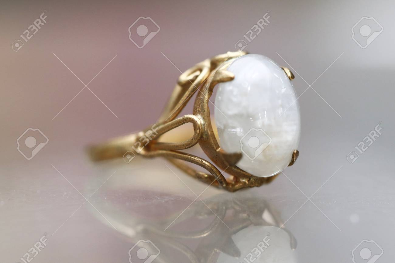 Opal white gem stone on gold ring
