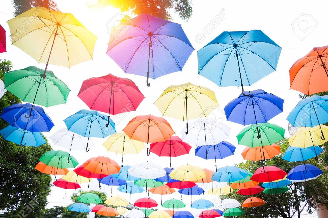 hanging colorful umbrellas background. Colorful umbrellas in the sky. Street decoration. - 60404897