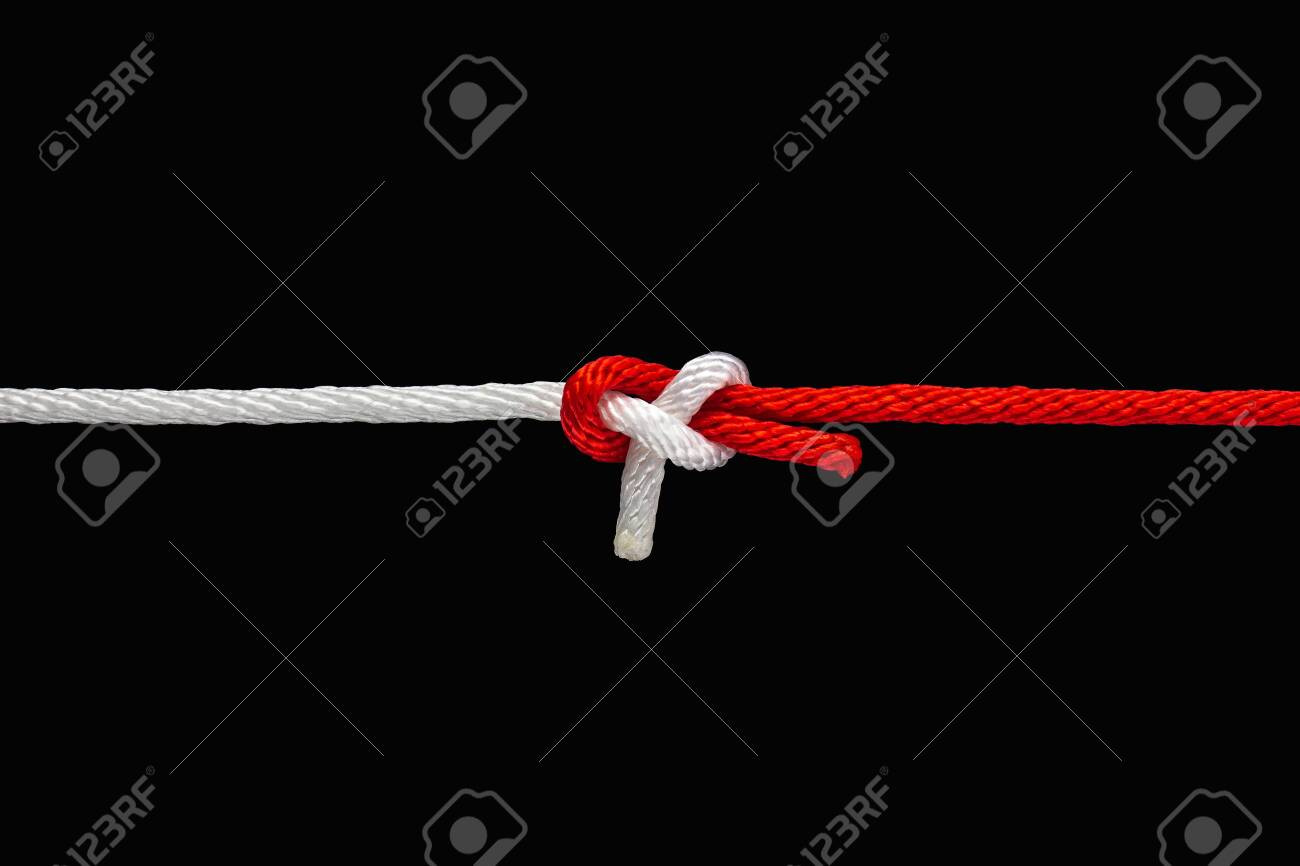 Tie the knot with red and white rope on black background with clipping path - 136726029