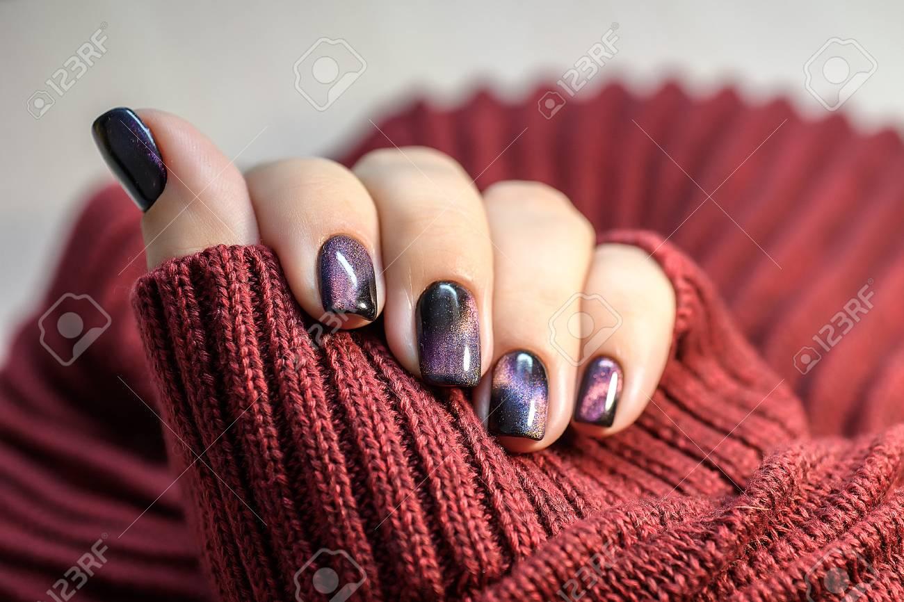 Beautiful nail polish in hand purple nail art manicure red beautiful nail polish in hand purple nail art manicure red background stock photo prinsesfo Image collections