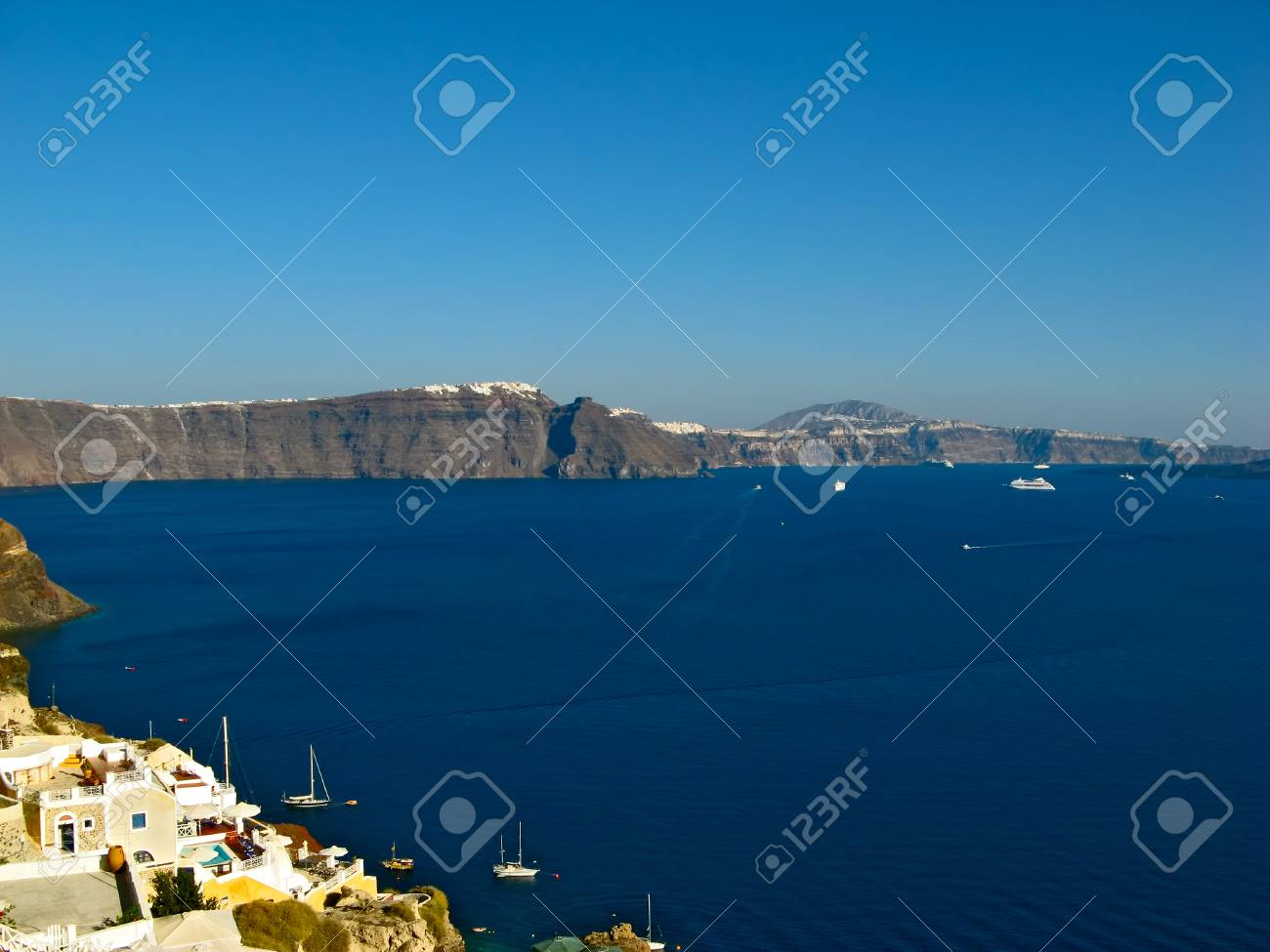 Santorini Volcano Caldera Lit By Afternoon Sunshine View From