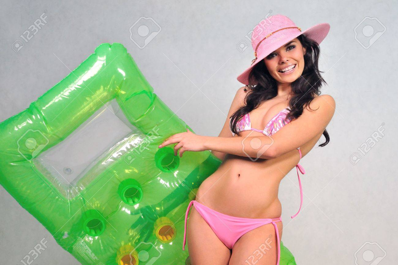 girl in a pink bikini summer hat and inflatable mattress Stock Photo - 6807049