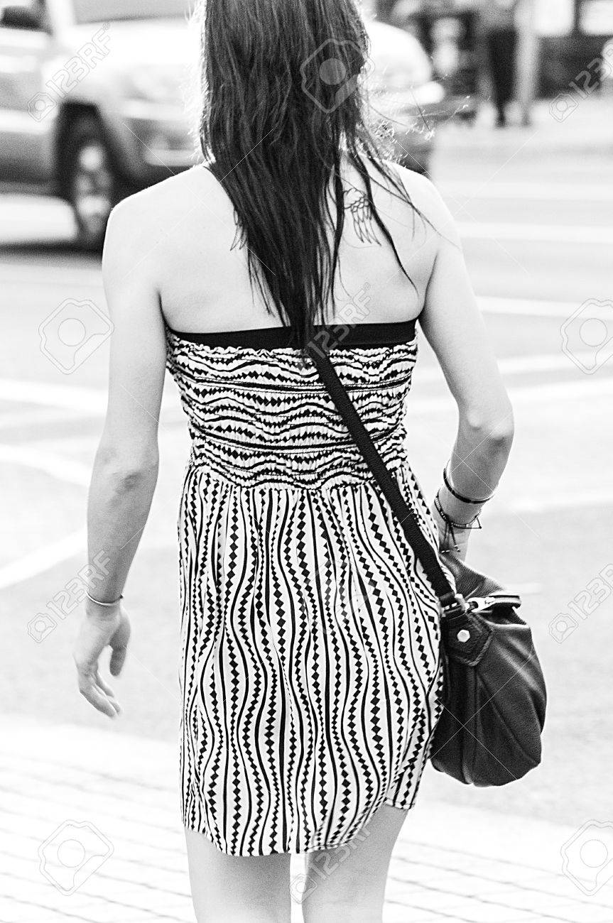 Bw Rear Shot Of Woman In Geometric Design Dress With Tattoo Stock