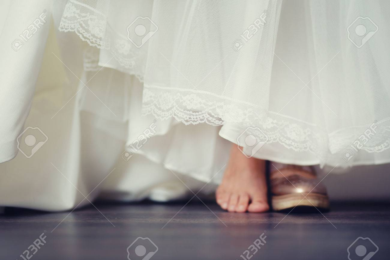 Background Blur Bride In Comfortable Wedding Shoes Sneakers The Concept Of Choosing Or