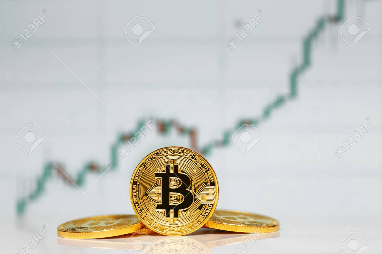 Gold Bitcoin on the background of the chart. - 85254840