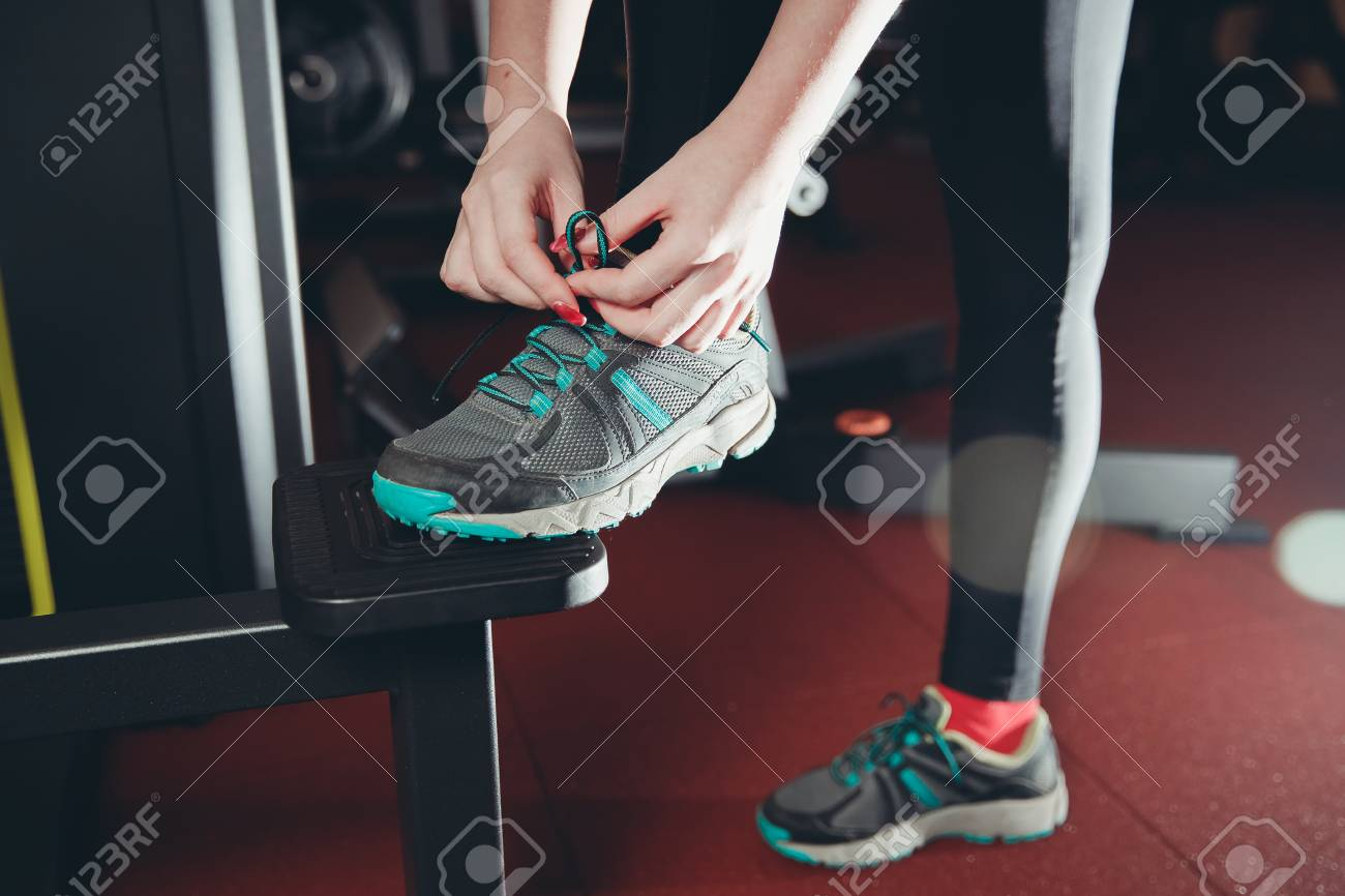 Girl Tying Shoelaces On Sports Shoes