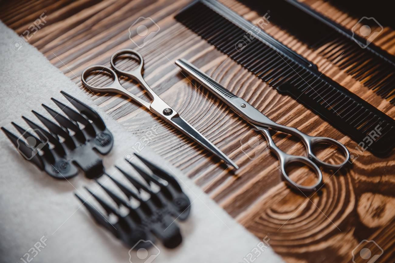 Men hair salon, cutting tools and beard close,up, scissors on..