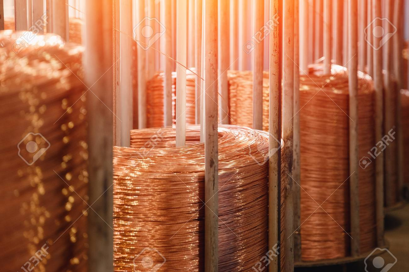 Production of copper wire, bronze cable in reels at factory. - 121364101