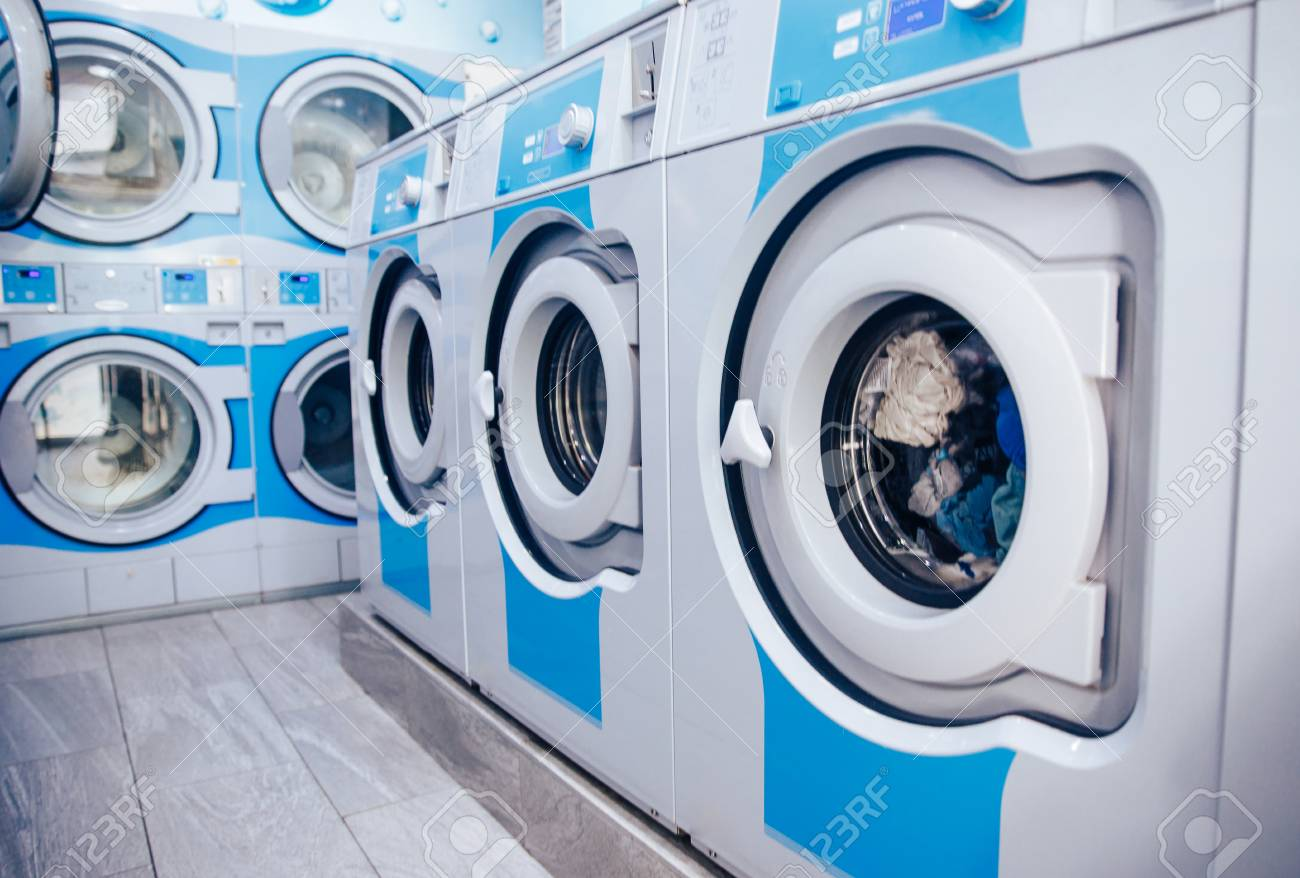 Row Of Industrial Laundry Machines In Commercial Laundromat... Stock Photo,  Picture And Royalty Free Image. Image 121363578.