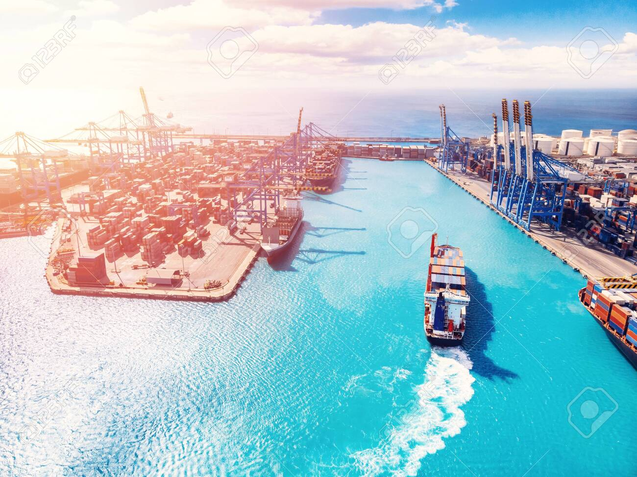 Cargo port business, logistics center. Ship is loading containers with crane. Aerial view. - 122206728