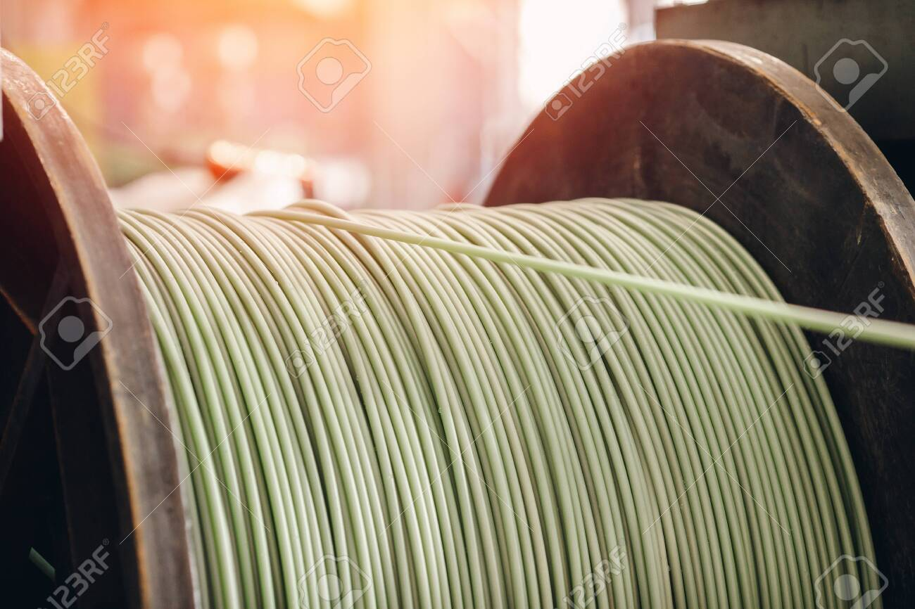Production of copper wire, bronze cable in reels at factory. - 122773507